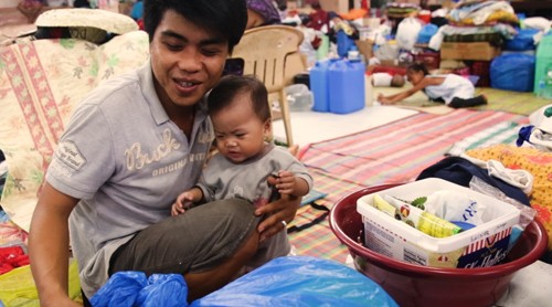 WATCH: A dad, a baby, and an evacuation center